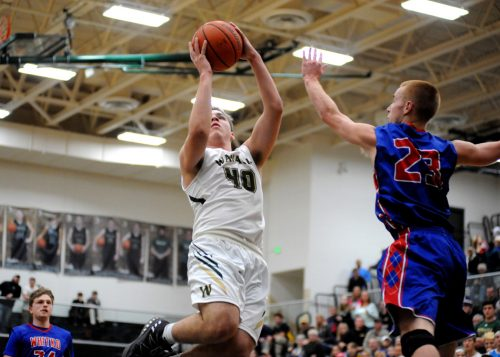 Trevon Coleman of Wawasee rises for a shot over Whitko's Nate Walpole.
