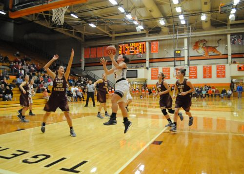 Warsaw's Page Desenberg takes the clear path to the rack.