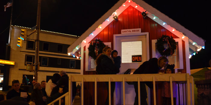 Families and children waited anxiously to meet Santa in Santa's House, sponsored by Optimist Club.