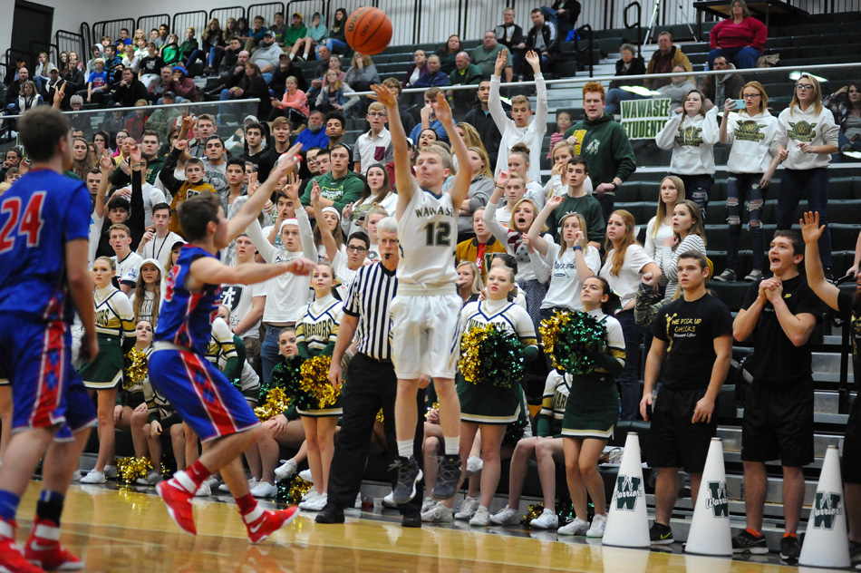 Wawasee's fan base waits in anticipation as Cameron Schlabach fires away what would be a tying three-pointer in what became a 54-47 Wawasee win over Whitko in a double-overtime thriller. (Photos by Mike Deak)