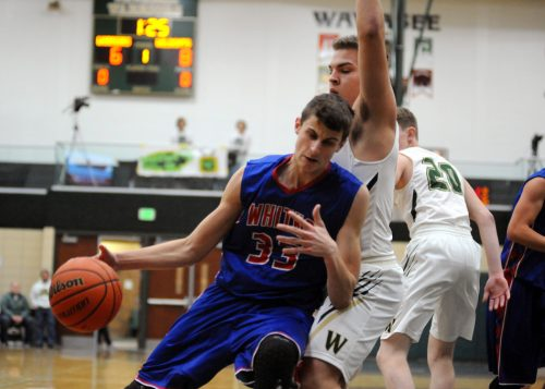 Whitko's Spencer Sroufe battles with Wawasee's Trevon Coleman.