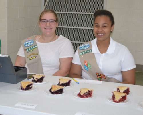 Girl Scouts Aly Kirkpatrick and Mia Washington man dessert table.