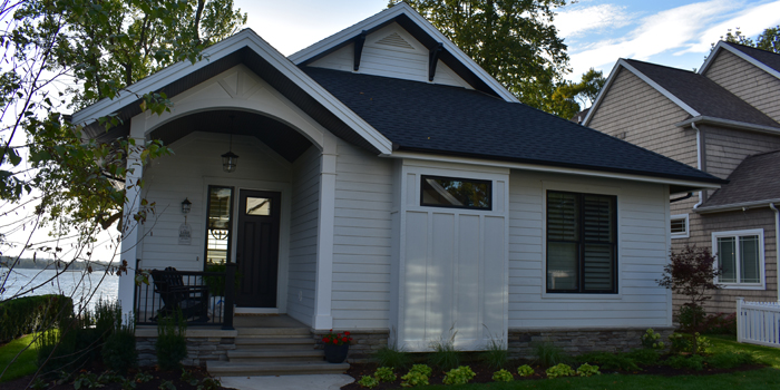 Located on Lake Wawasee, this contemporary cottage was completed by Milestone Construction.
